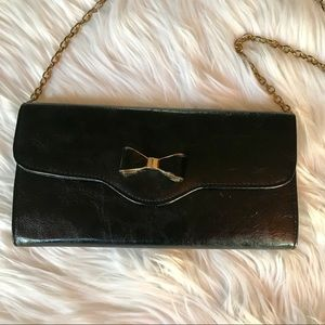 Style & Co faux leather clutch with bow